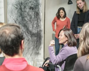 Mikyoung engages with students in Assistant Professor Katie Jenkins' class.